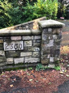 Ervin has a stone wall, which borders his property and runs alongside busy West Lake Sammamish Parkway.
